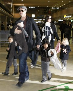 U.S. actors Pitt and Jolie arrive with their children at Narita airport