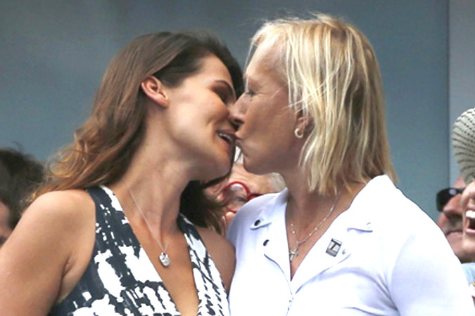 Tennis great Martina Navratilova and her partner Lemigova celebrate after Nishikori of Japan defeated Djokovic of Serbia in their semi-final match at the 2014 U.S. Open tennis tournament in New York