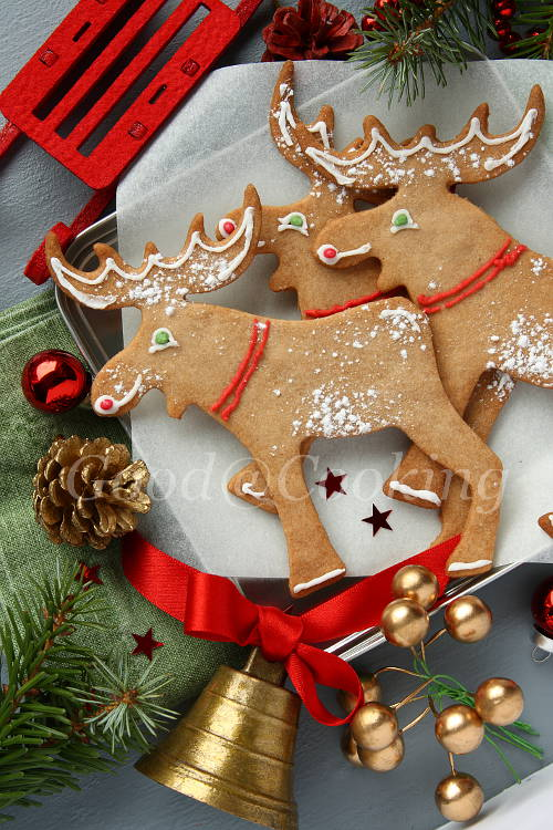 Christmas gingerbread elk-shaped cookies with christmas decoration.