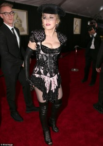 257BB3D400000578-0-Ole_Madonna_shimmies_her_HUGE_cleavage_while_dressed_as_a_sexy_m-m-2_1423437940821