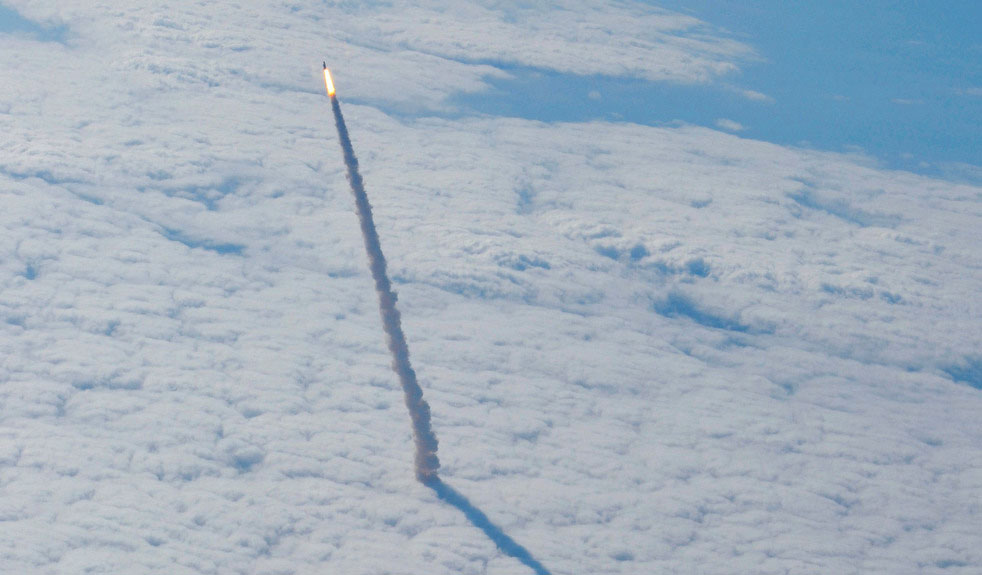 This image provided by NASA shows an image photographed from a shuttle training aircraft, as the space shuttle Endeavour and its six-member crew head toward Earth orbit and rendezvous with the International Space Station Monday May 16, 2011. (AP Photo/NASA)