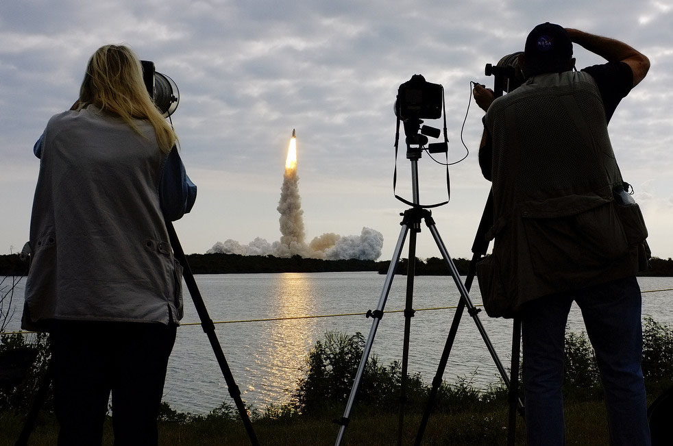 Photographers capture the launch of space shuttle Endeavour at Cape Canaveral, Fla., on Monday, May 16, 2011.  (AP Photo/J. David Ake)