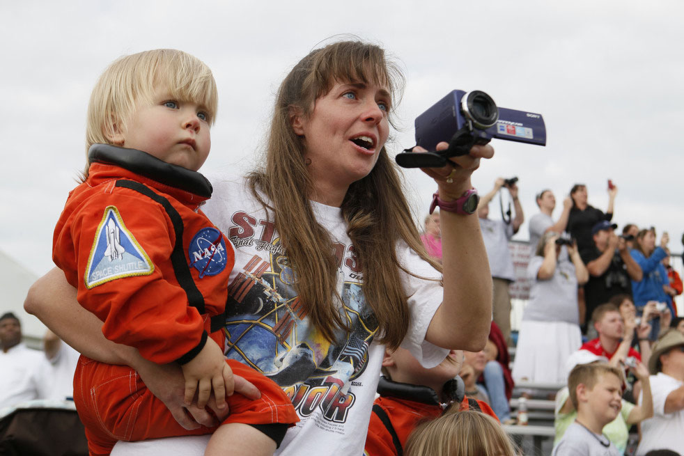 Joy Lewis holds her son Kaleb Lewis, 1, of Stafford, Va., as they watch lift off of Endeavour from the Rocket Garden.at the Kennedy Space Center Visitors Center in Cape Canaveral, Fla., Monday, May 16, 2011.(AP Photo/Julie Fletcher)