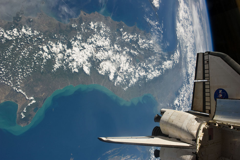 This Thursday, May 19, 2011 picture provided by NASA shows the space shuttle Endeavour docked with the International Space Station and Italy seen in the background. (AP Photo/NASA)